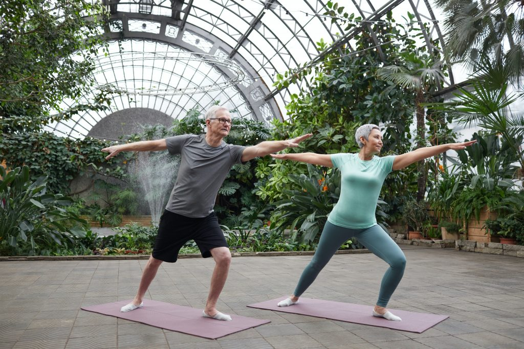 adults doing yoga to prevent muscle loss from aging
