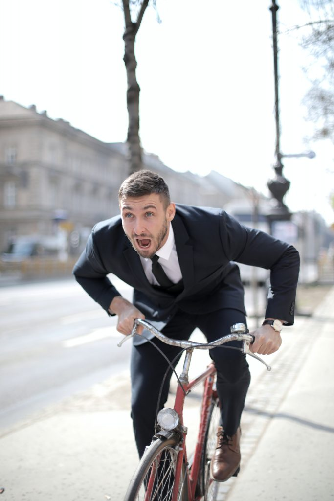 man on a bike to reduce severity of after workout sore muscles