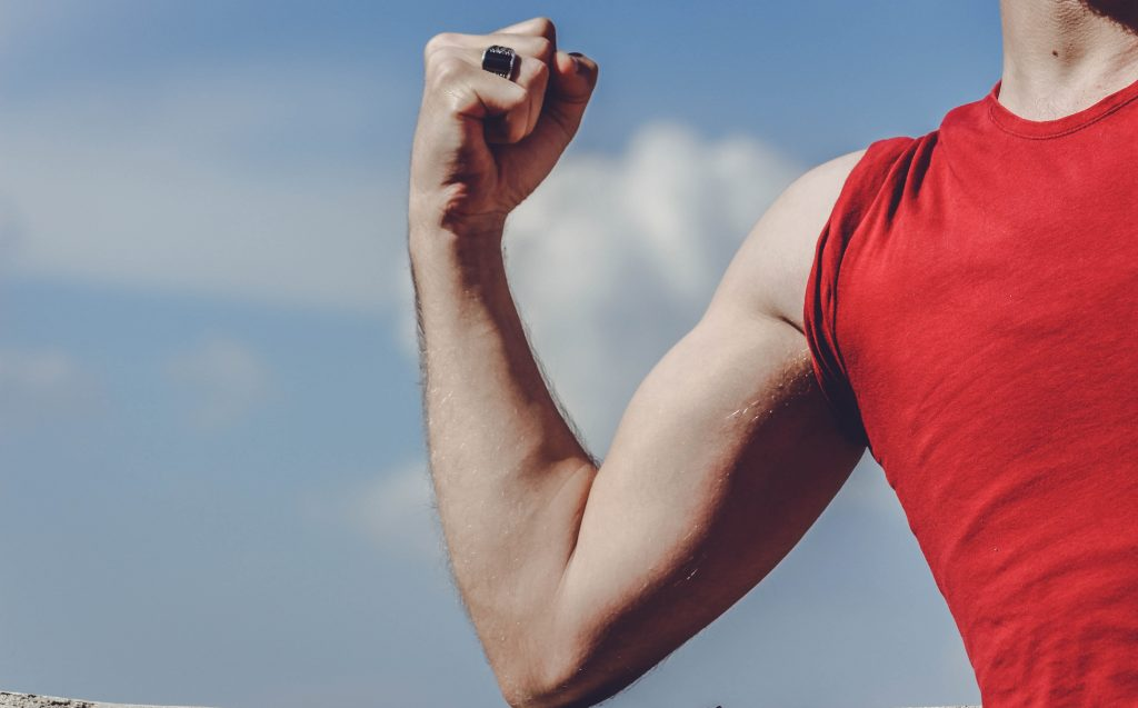 Man has after workout sore muscles